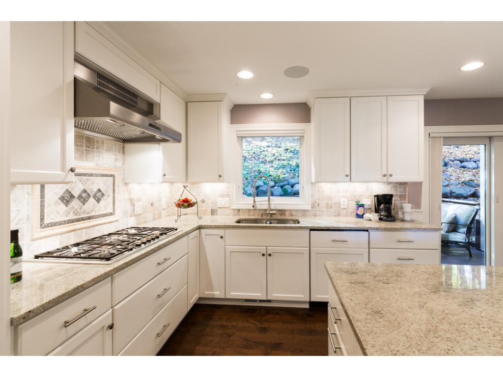 Alternate view of the kitchen highlights the stainless steel gas cooktop & hood. Built-in surround sound with Klipsch speakers can be found thru-out the whole house. All windows replaced in 2010 w/Marvin Ultimate casement & double hung windows.