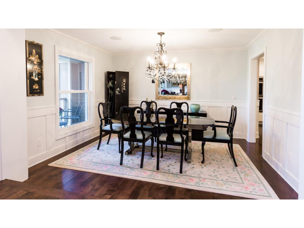 Spacious dining room provides plenty of space for a large table & family gatherings. Nearby foyer presents 16' ceiling with elegant bronze chandelier. An in-home security system provides added peace of mind w/ motion sensors & cell phone back up.