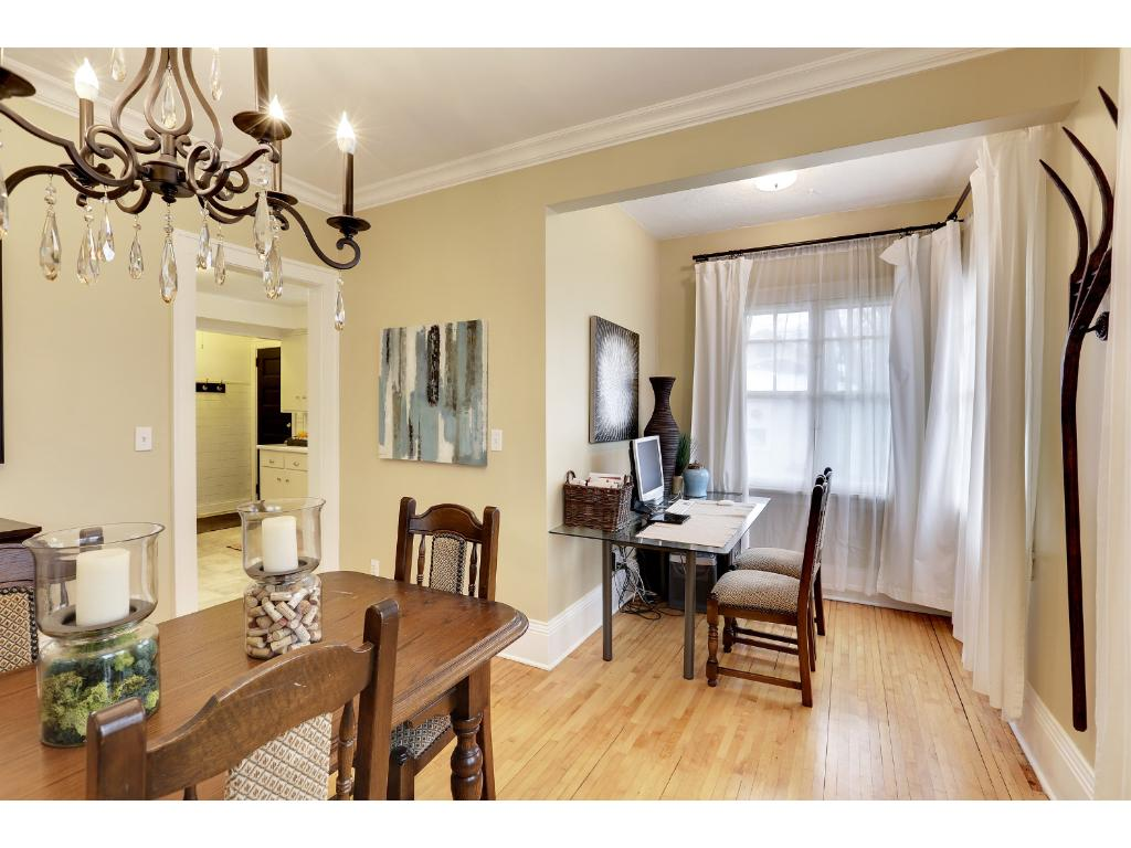 A charming separate living space off of the dining room creates a perfect office/work space for everyday easy use.