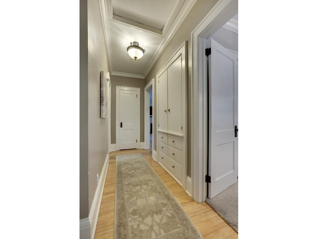 The hallway trim, interior doors and window trim were all stripped and the wood work was repainted.  Built-in cabinetry offers plenty of storage.