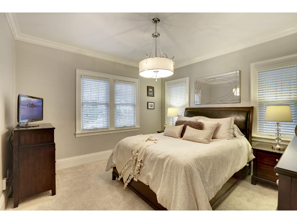 The master bedroom is expansive, complete with new custom carpet selection, lighting fixture, millwork and custom color.