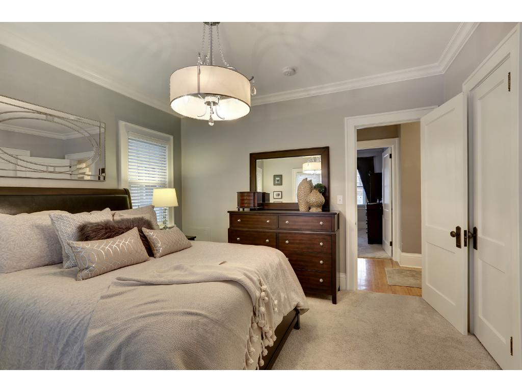 This room can support a king bed and furniture pieces and offers generous closet space.