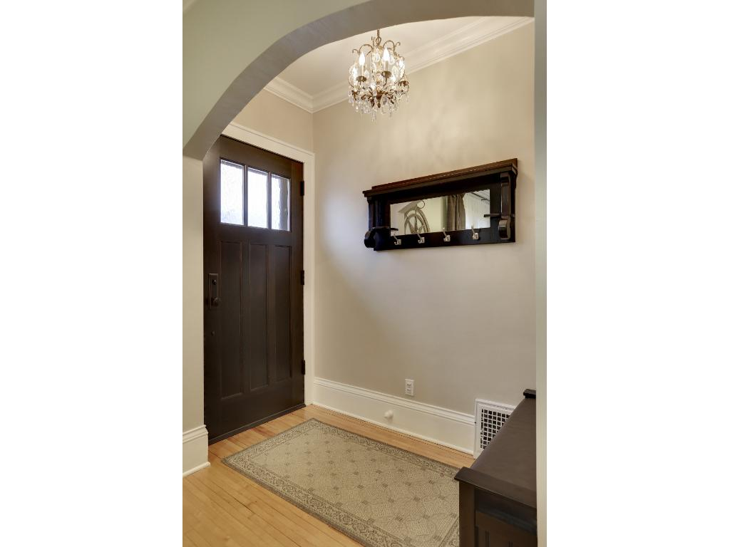 Gorgeous crown molding, custom designed front door entry by A&A Millwork, beautiful refinished maple floors and a custom light fixture welcome you as you enter this lovely space.