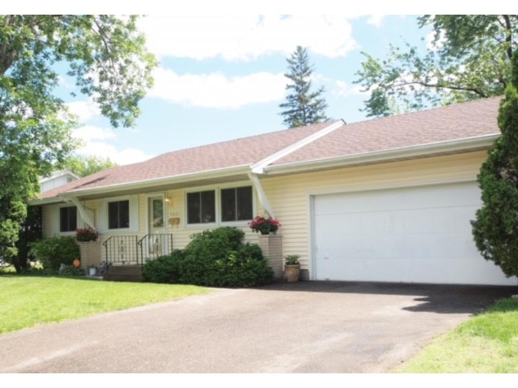 Welcome to 5001 78th Lane North with its excellent curb appeal and wonderful lot plus an attached 2 car garage