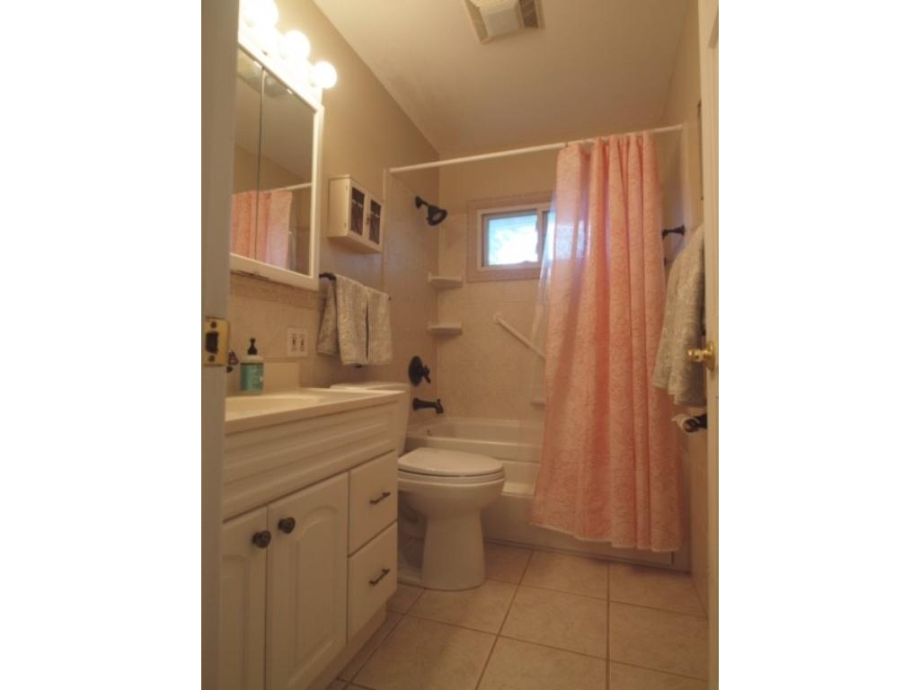 Updated full bathroom has a Jacuzzi tub