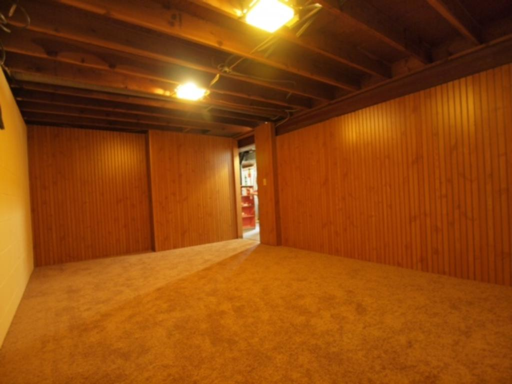 The lower level rec room also features new carpet and paint - plenty of room to spread out in this home