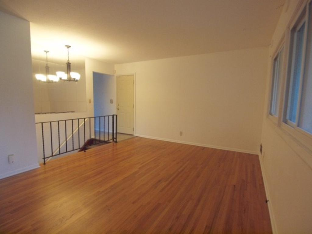 Enter into the living room with its gorgeous, newly refinished hardwood floor and fresh paint