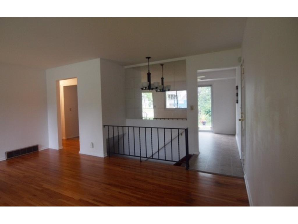 Great floor plan with easy access to the lower level, kitchen/dining room, and hallway to the 3 main floor bedrooms and full bath