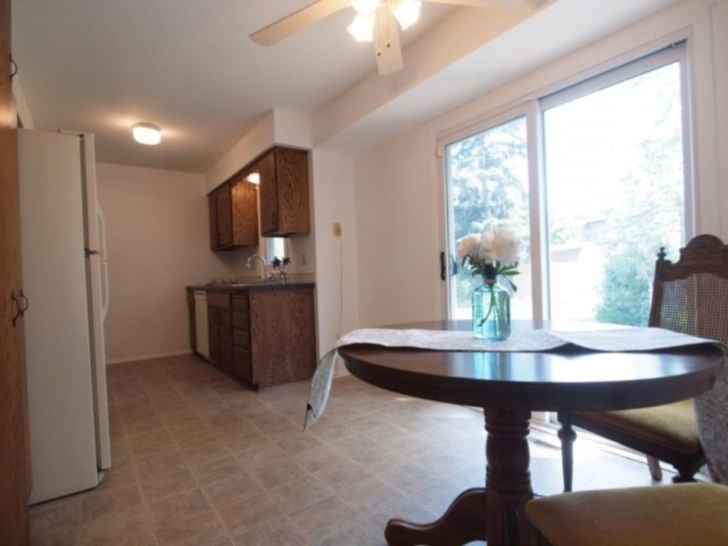 Perfectly sized dining area with a view of the beautiful back yard through the sliding glass doors