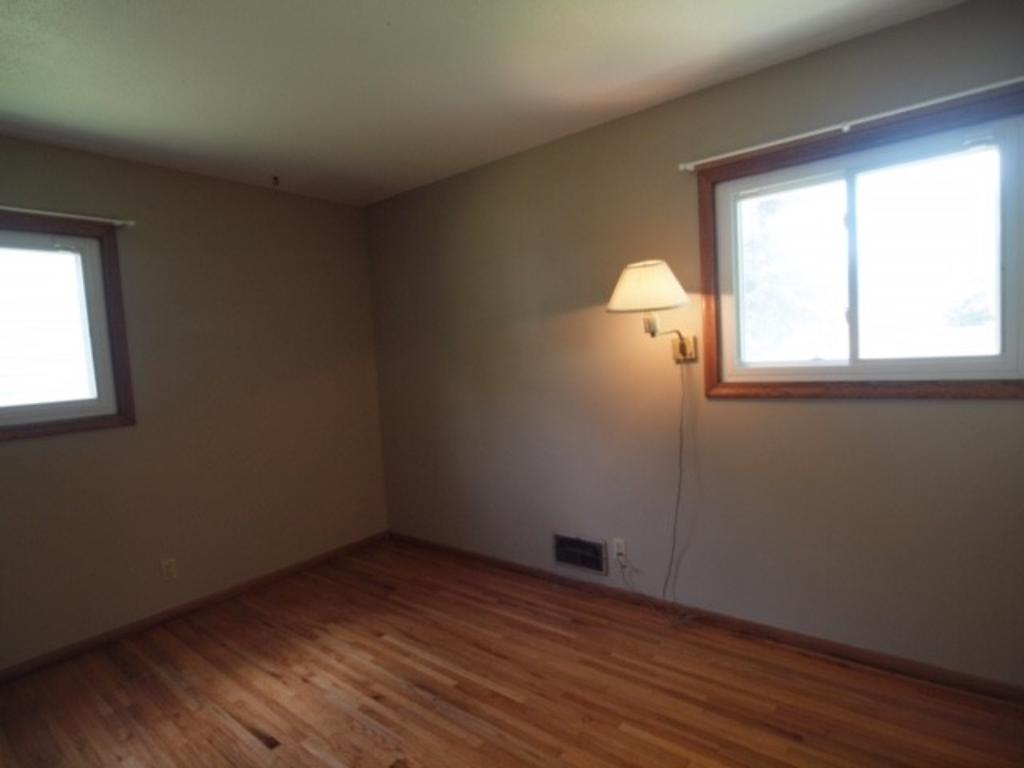 Master bedroom has 2 large windows - gorgeous hardwood flooring in all 3 main floor bedrooms, and all are freshly painted