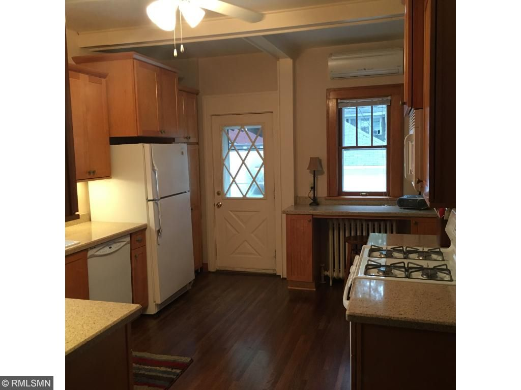Remodeled kitchen maintains the original charm with it's design.