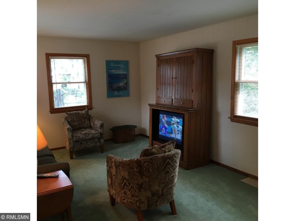 Main floor Family Room.with leaded glass windows.