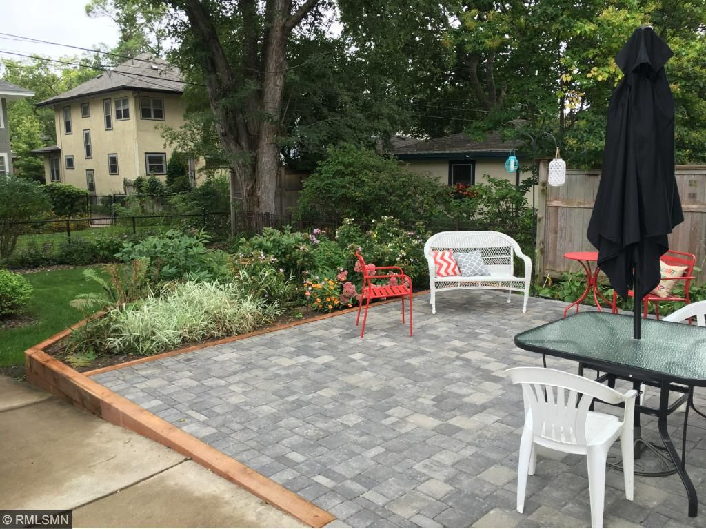 Huge patio overlooking beautifully landscaped yard.