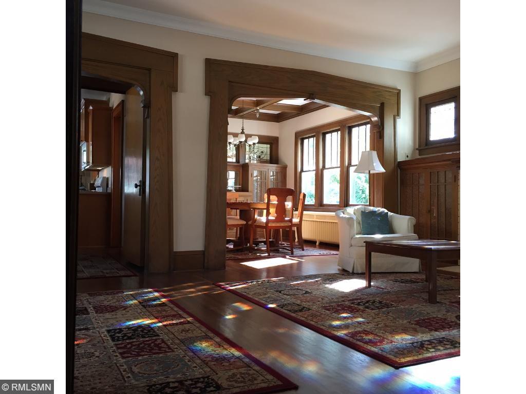 Open floor plan with meticulous Arts and Crafts woodwork hardwood floors.
