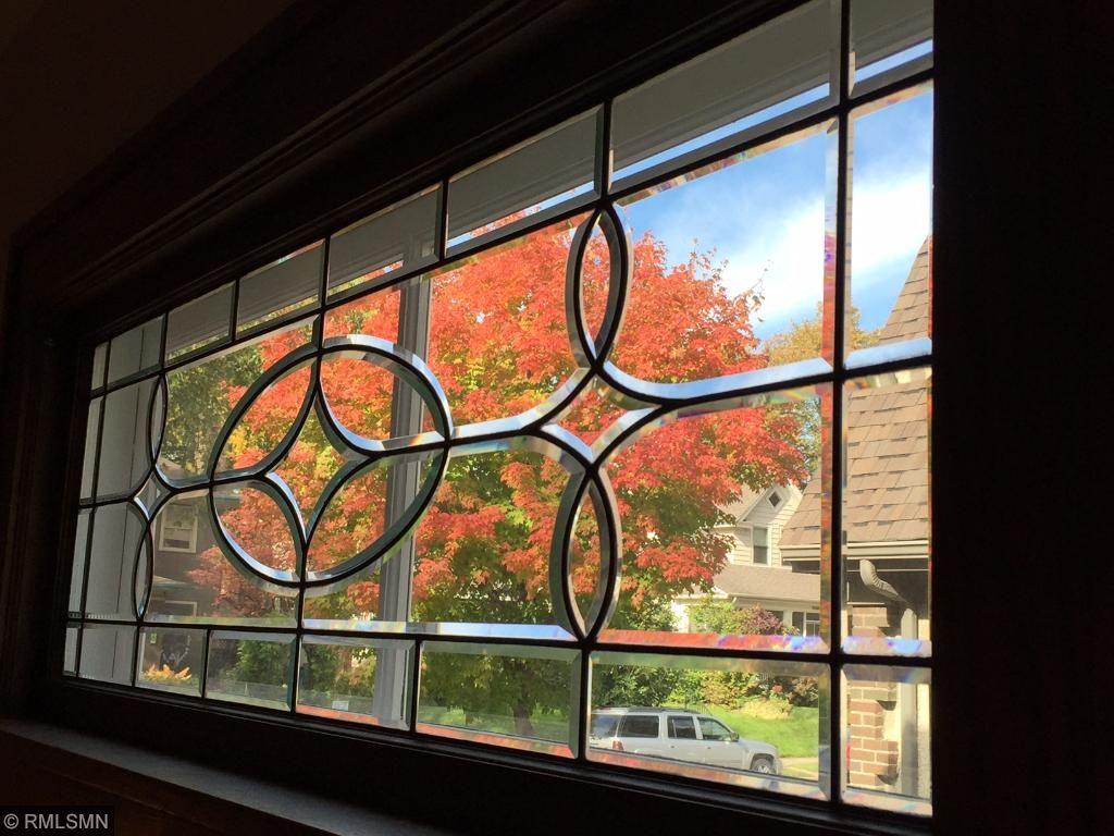 Stunning leaded glass windows cast prism like patterns on sunny days.