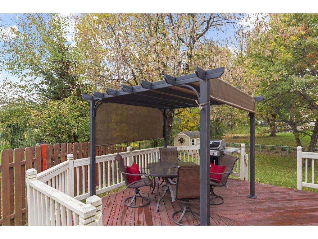 Deck is just off of the kitchen and informal dining area.  What a great area for barbecues!  Pergola will be going with the sellers.