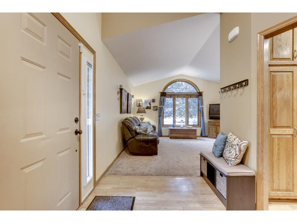 You are greeted by this large foyer and vaulted ceilings!