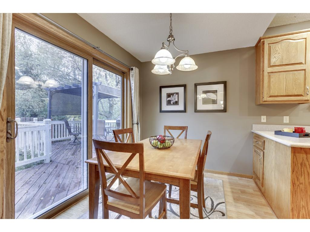 Kitchen provides an informal dining area with a walk-out to the deck.