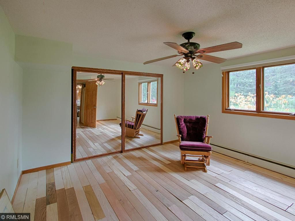 Fourth bedroom on lower level. Bedroom offers a mirrored cedar closet.
