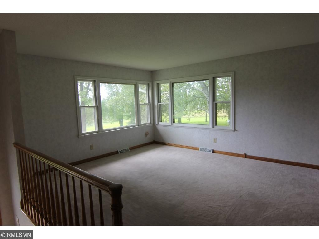 One of 3 bedrooms on the main level. All feature hardwood floors and 6 panel oak doors/woodwork.