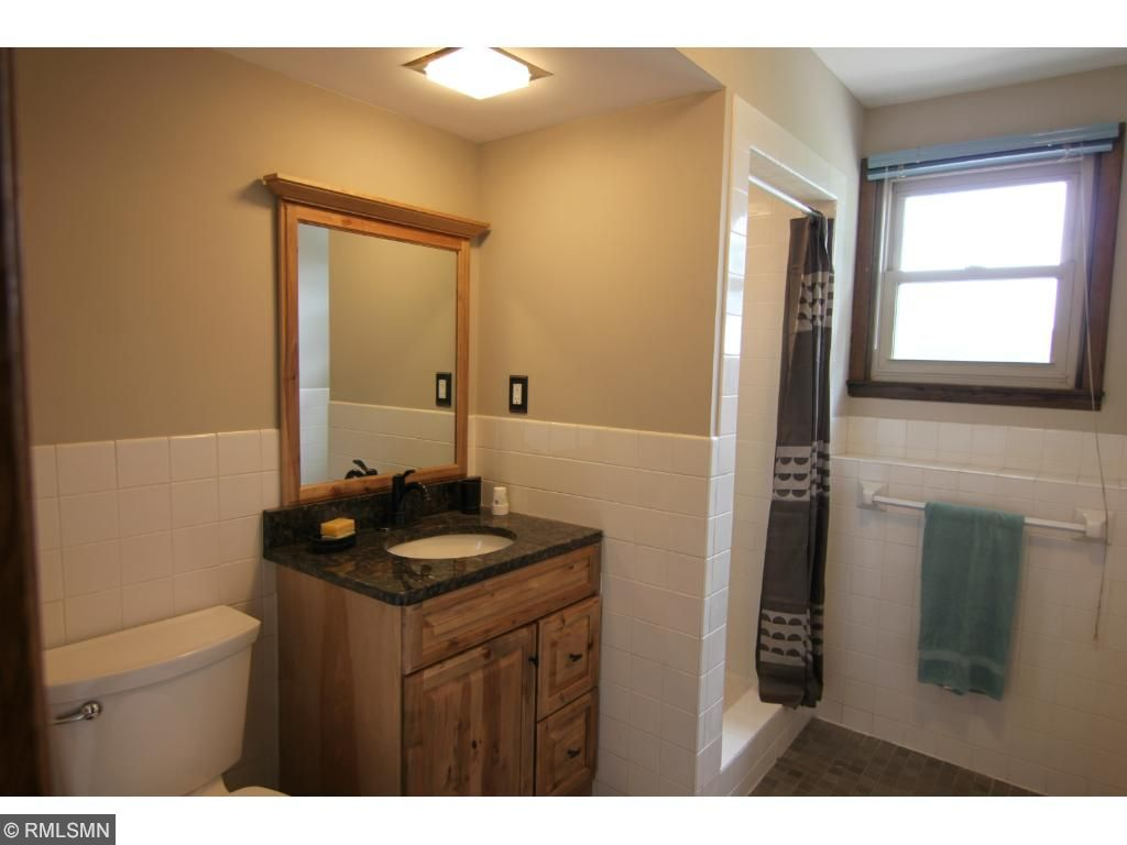 Spacious laundry with storage and counter. Note the newer front loading washer & dryer will stay with the home.