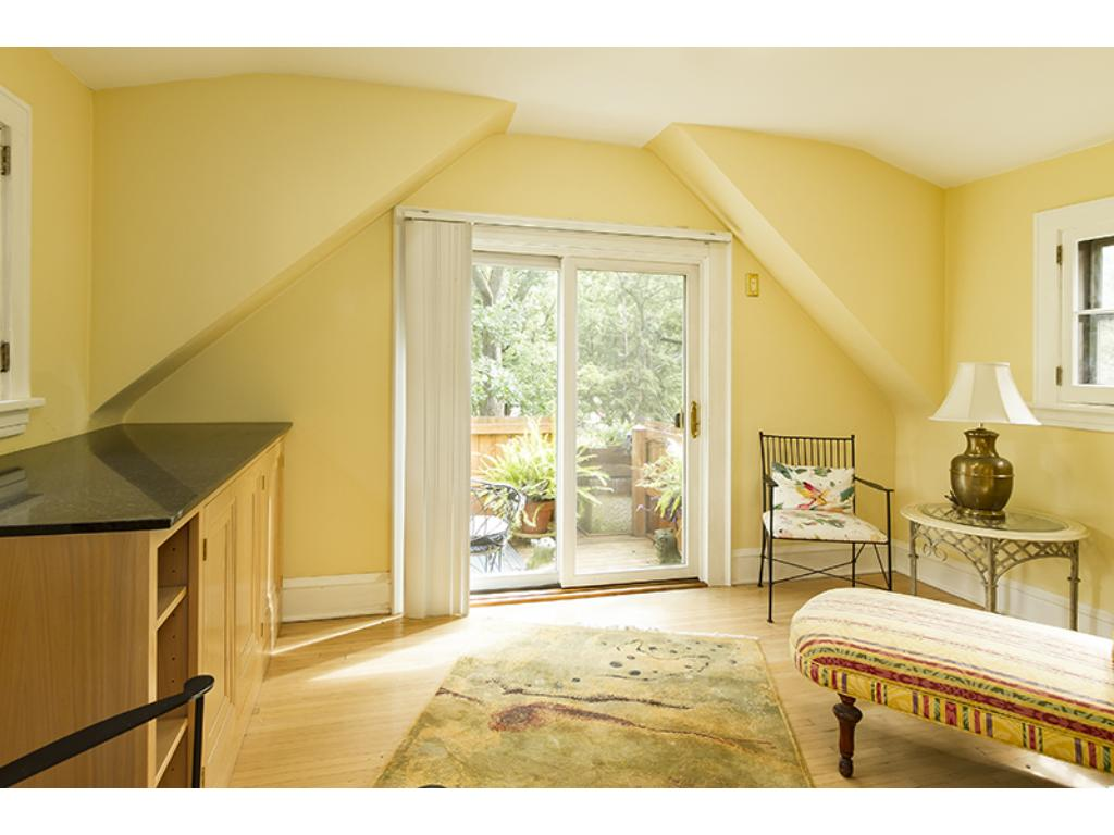Sunny sitting room off the master bedroom with a private balcony