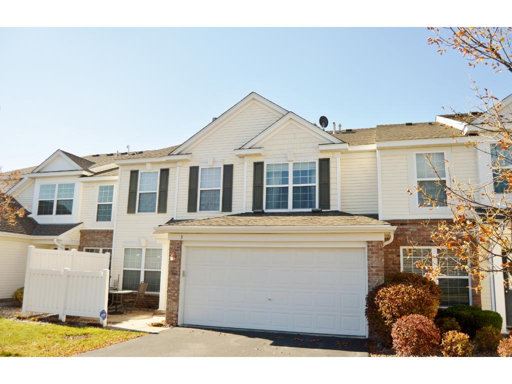 Spacious living room with gas fireplace. Open floor plan to dining and kitchen area.
