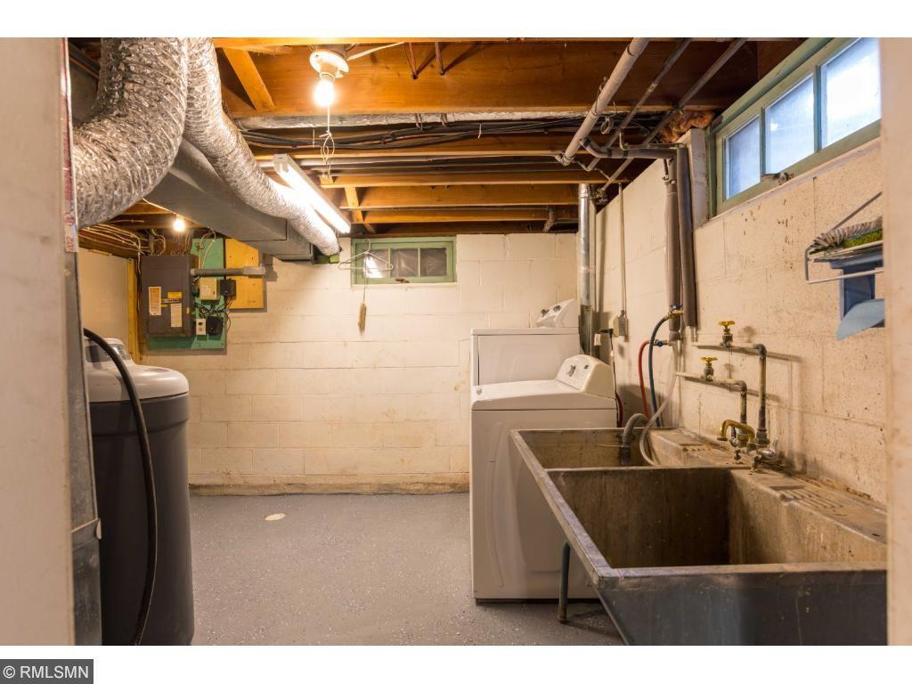 Laundry has a double concrete sink.