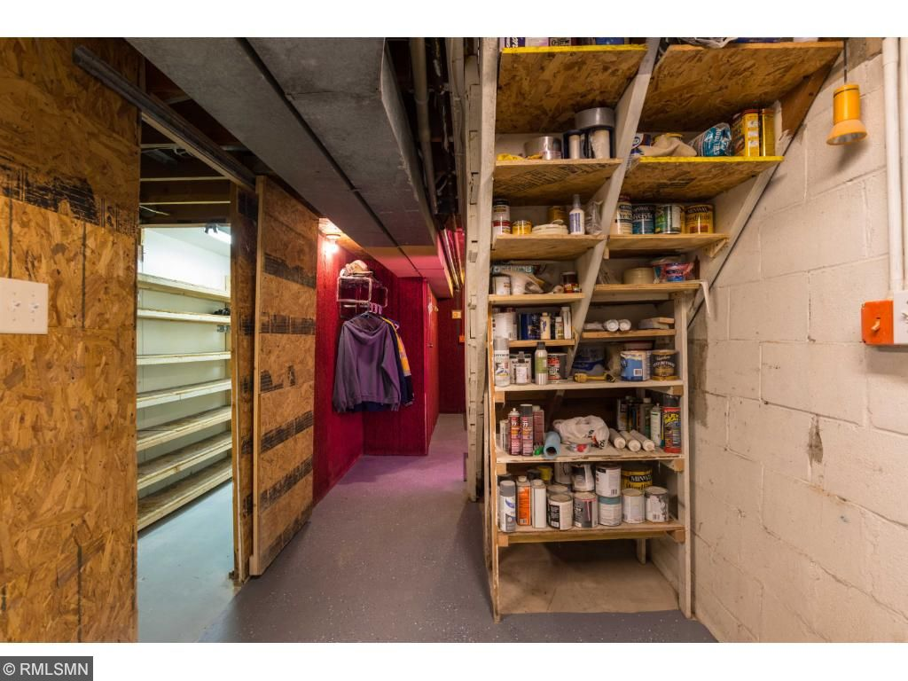 Need a parts room? Shelving fills this 12' by 6' space and has room for a desk.