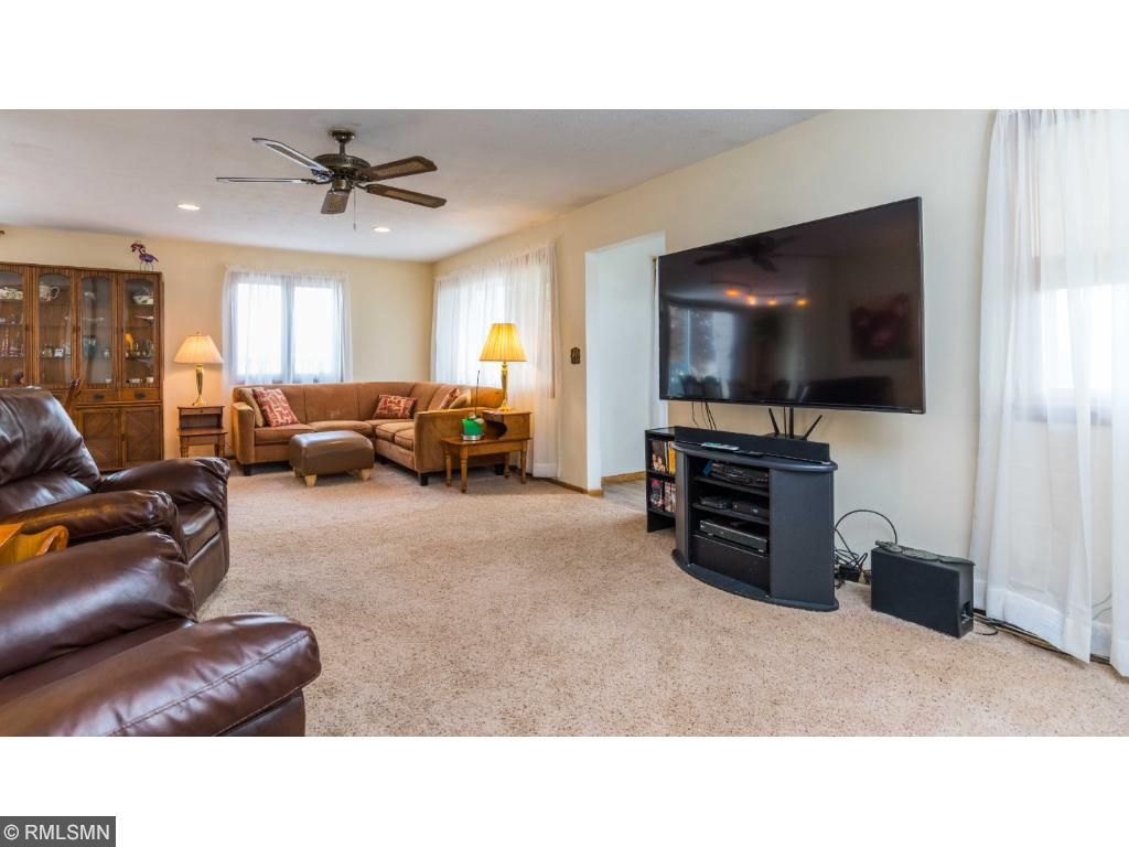 """Living room with large picture and it still leaves room for a mounted 70"""" TV."""