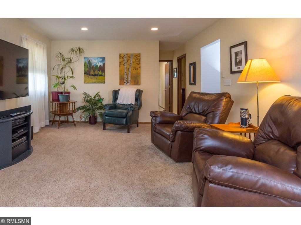 L-shaped living room has plenty of space for everyone.