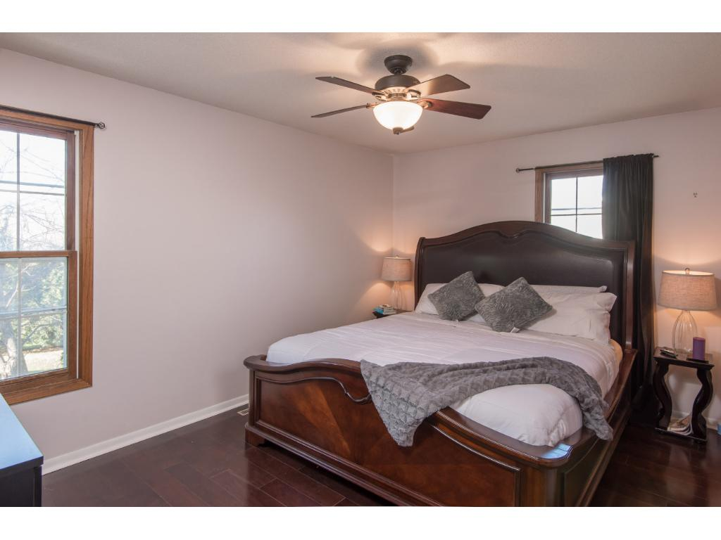 Master bedroom with walk in closet and walk thru to full bathroom.