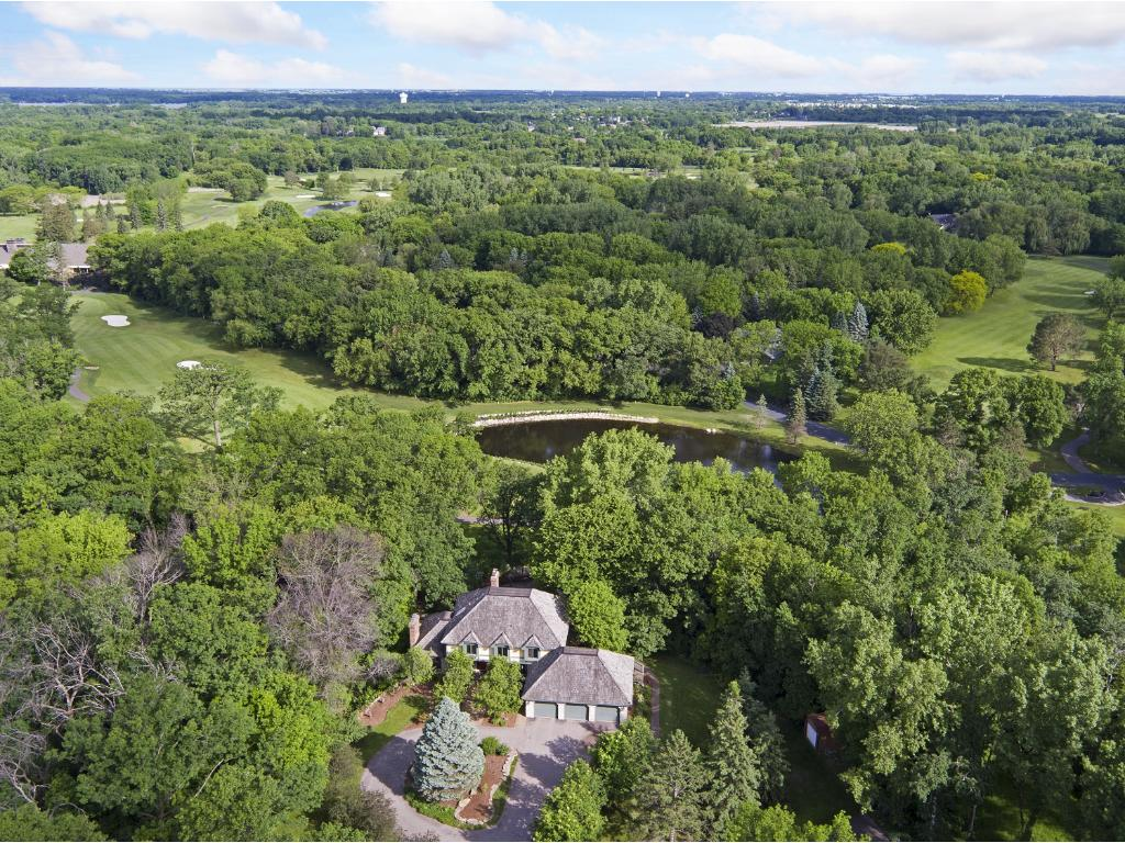 Welcome to the privacy afforded by over two acres backing onto Dellwood Country Club.