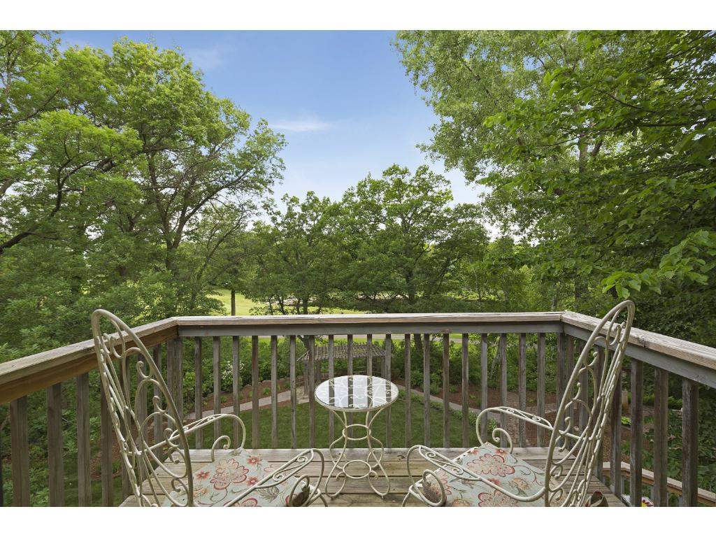 Enjoy the lovely landscaping and private backyard while you gaze at the pond from the master bedroom balcony.