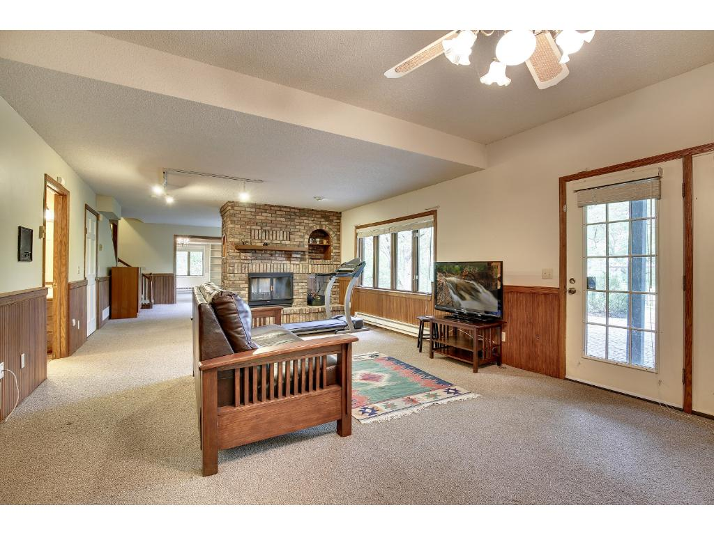 The lower level rec room is perfect for kids and/or casual entertaining.  It also walks out to the expansive paver patio outside.