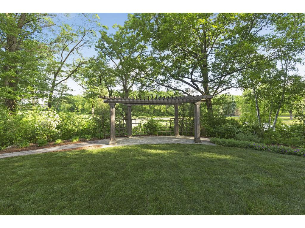 There are two pergolas, a fire pit, and gazebo to enjoy in the backyard.