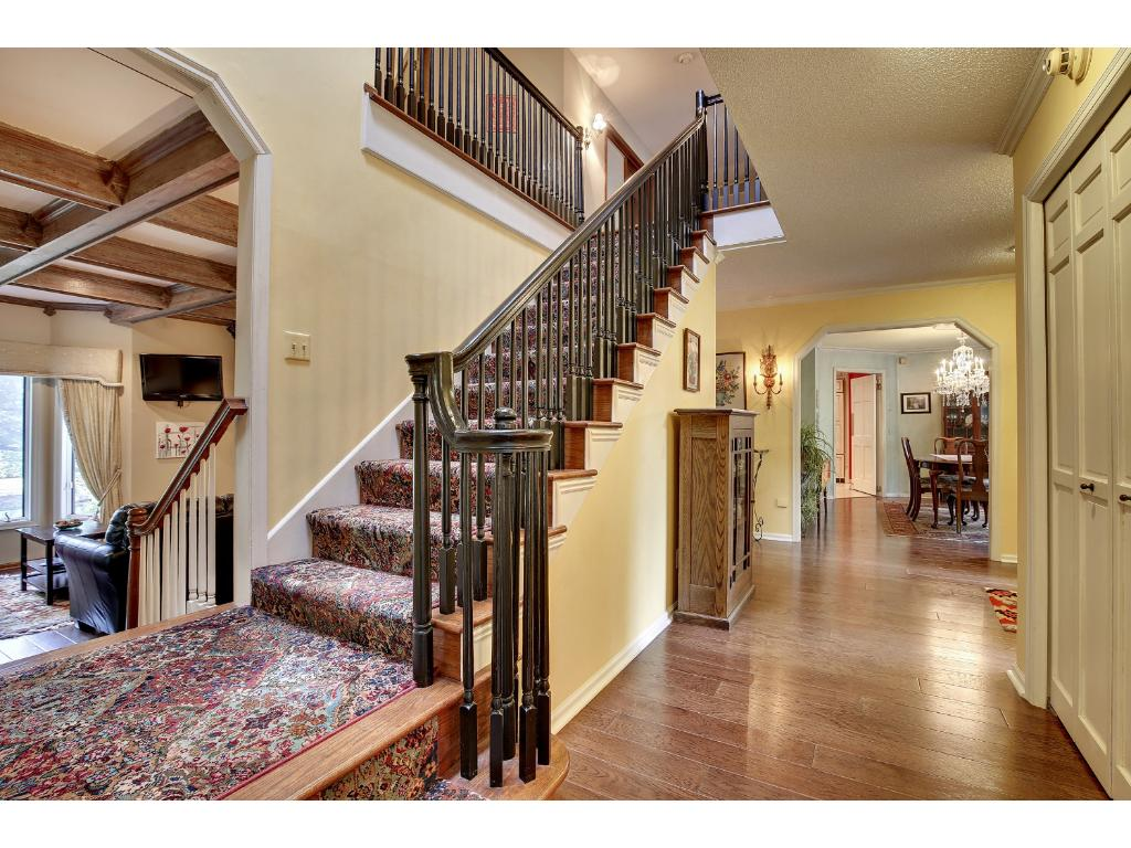 The grand iron staircase is a showpiece in the middle of the home and sets the tone the moment you walk through the front door.