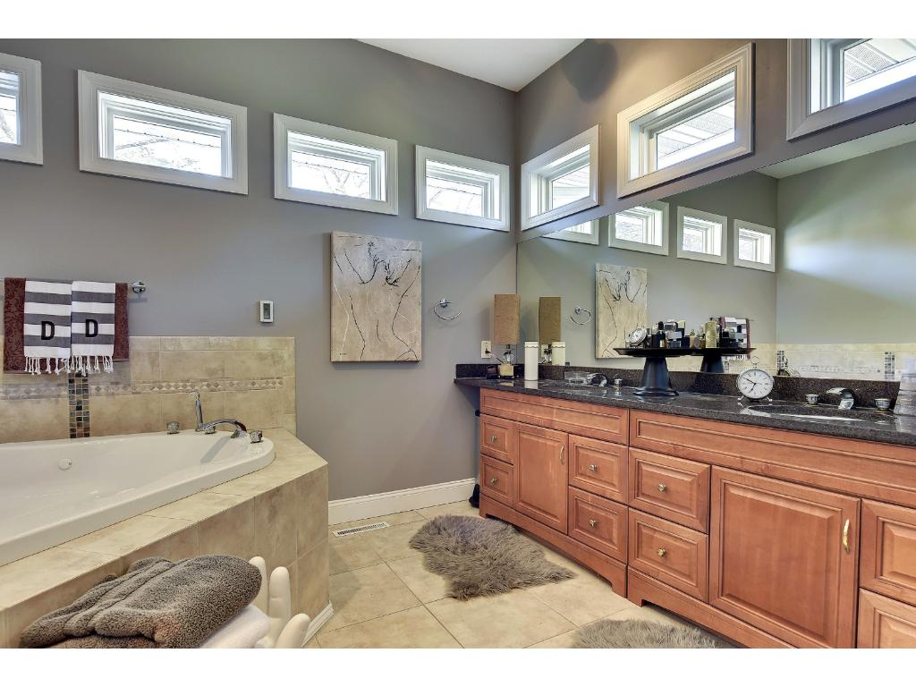 Double sink vanity with plenty of natural light in the private master bath with heated floors