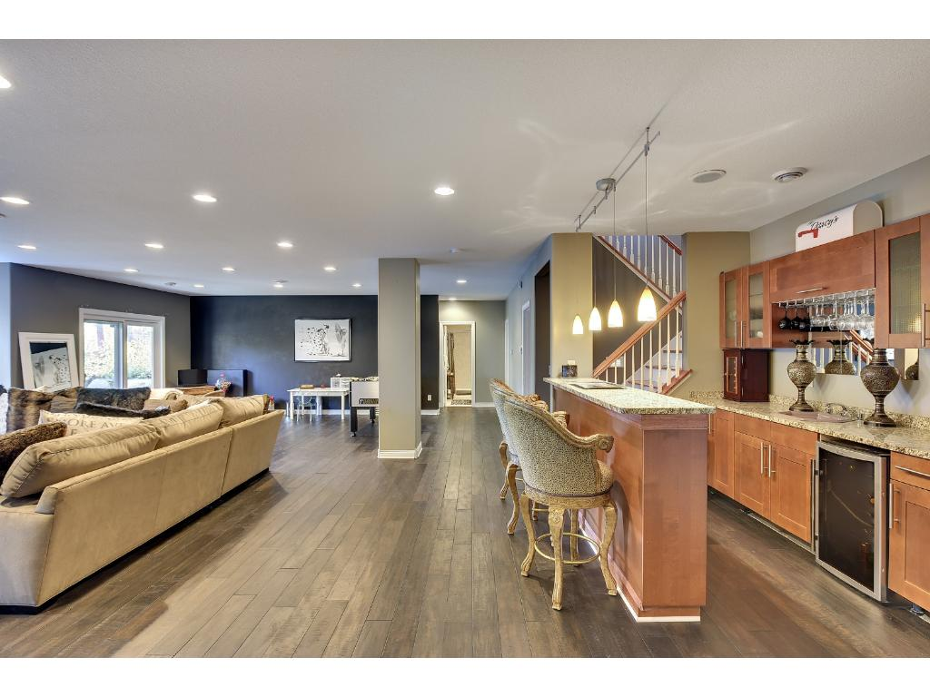 Large open and bright lower level with wet bar and fireplace