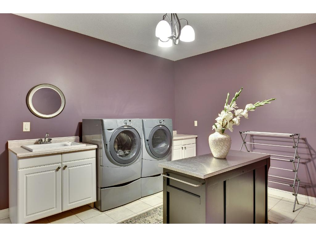 Large laundry room with utility sink and folding table