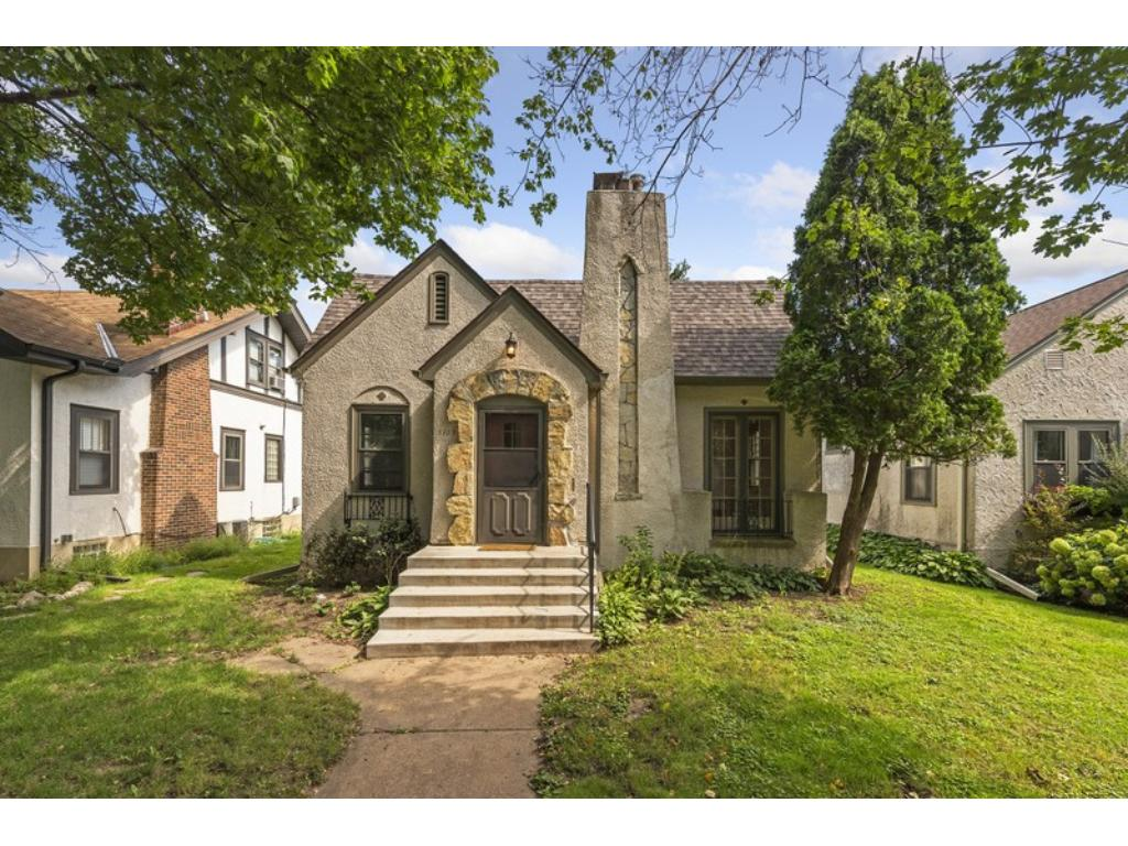 Uber charming Tudor bungalow offers fabulous location just 1 block to Minnehaha Parkway, in the coveted Hale neighborhood!
