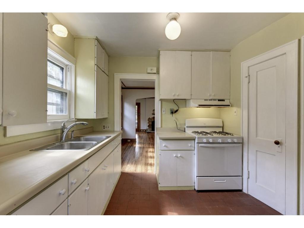 Floor to ceiling cabinetry & pantry, plus Terra Cotta floor!