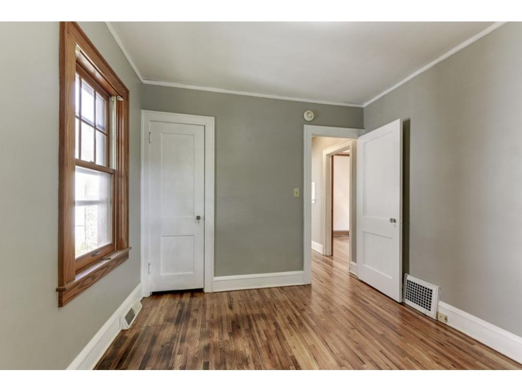 One bedroom with natural woodwork & the other with enameled!