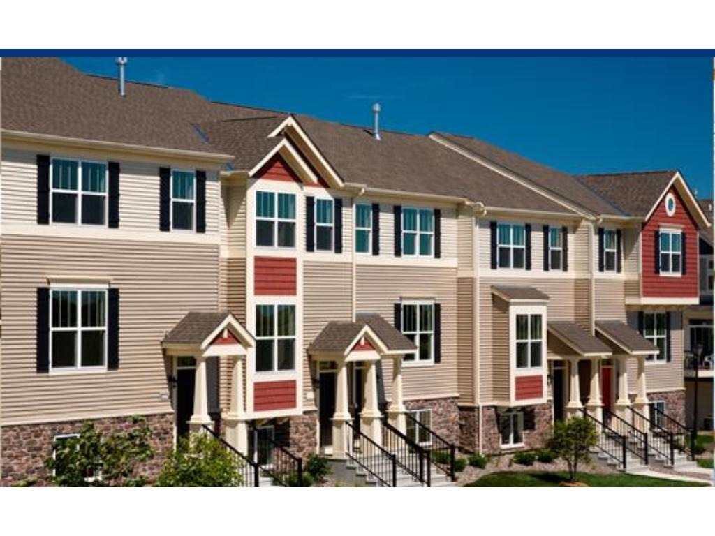 Sample exterior photo.  Carriage-style row homes with private entrance.