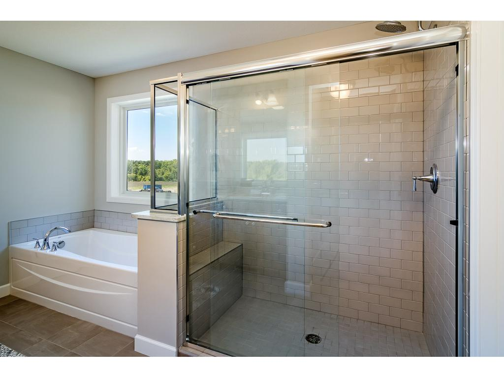 Large tile shower with built-in bench and soaking tub