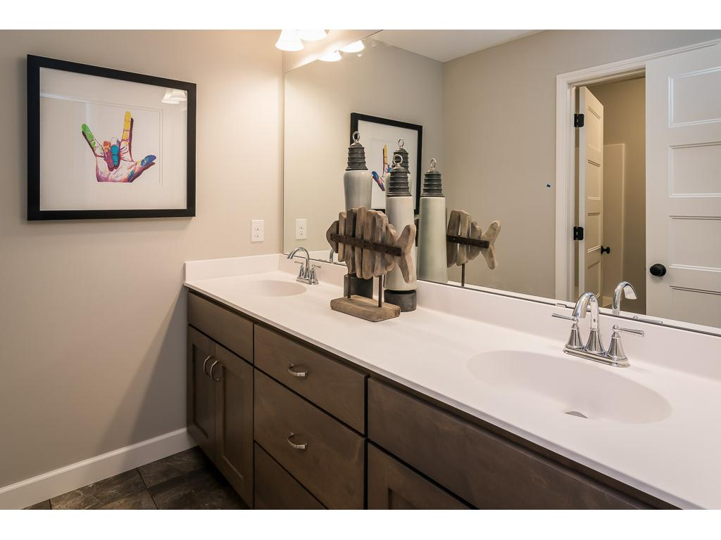 Main bath on upper level.  Large vanity with separate space for tub and toilet.