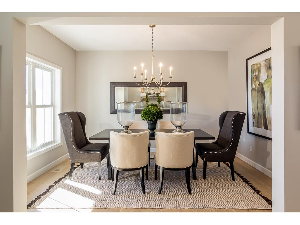 Formal dining room with hardwood flooring