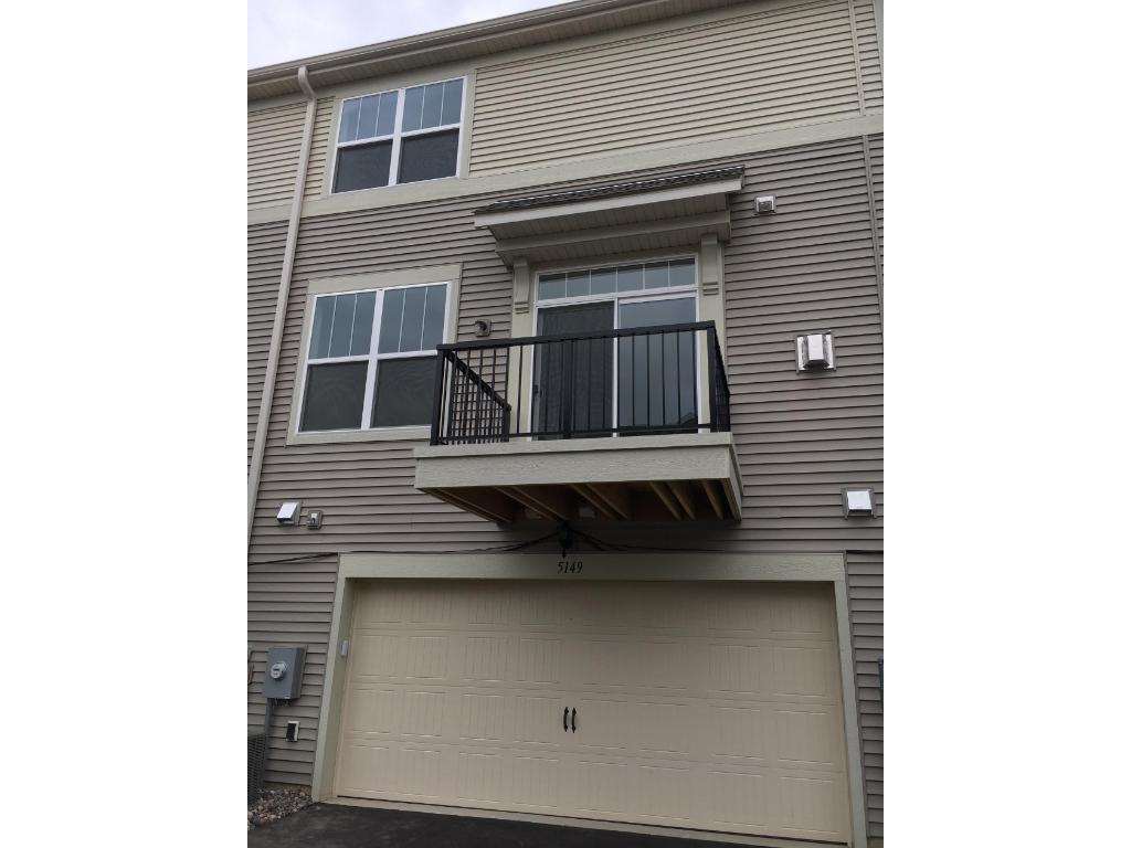 Two-vehicle, tuck-under, insulated garage with side storage space.  Outdoor deck off main level family room.