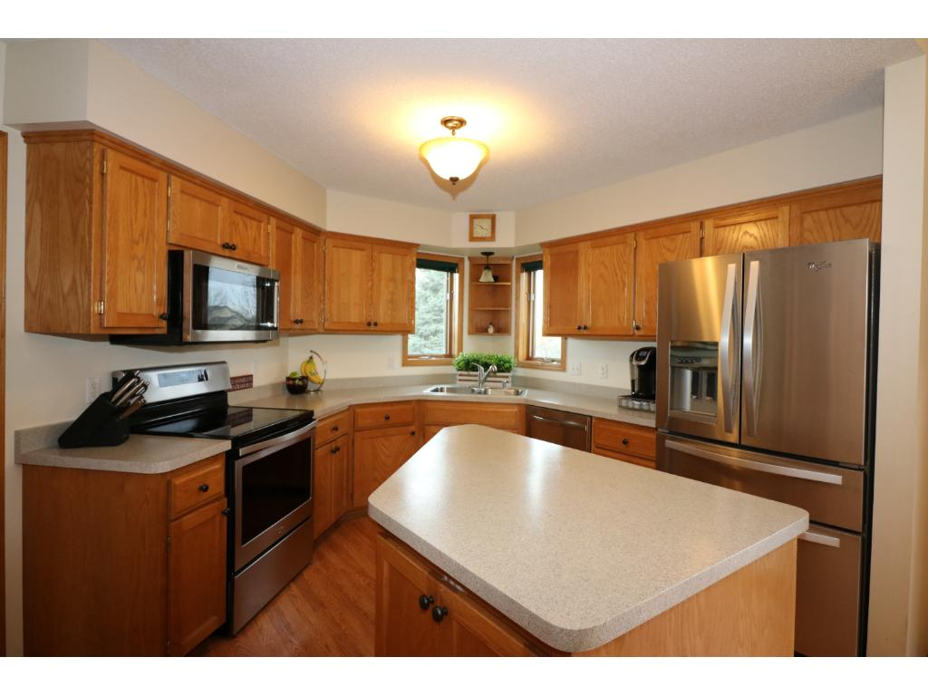New stainless steel appliances and counter tops.