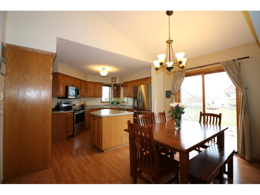 Kitchen with center island and patio door that walks out to deck.